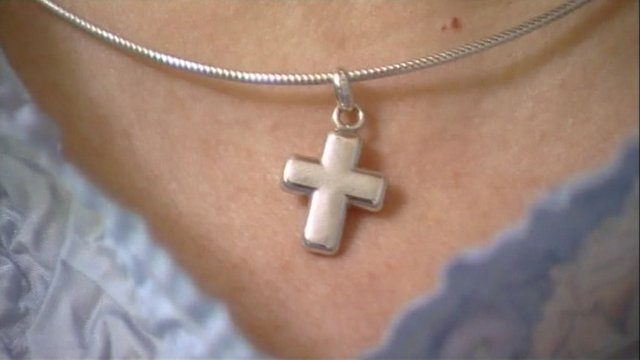 Cross pendant on necklace
