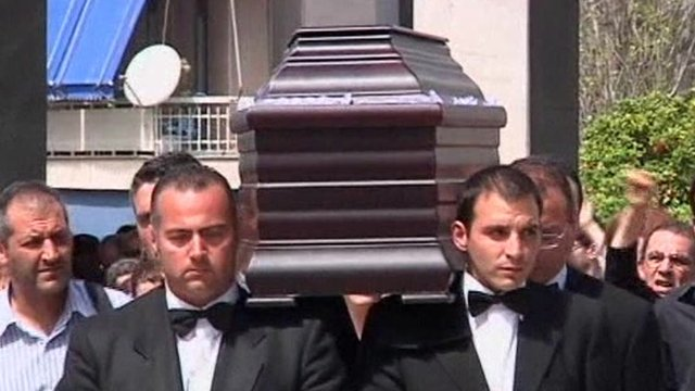 The coffin of Dimitris Christoulas being carried