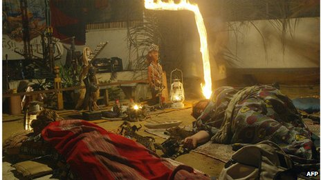 Two European women rest in a temple in Gabon after taking ibogaine with the Bwiti tribe