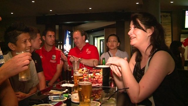 British football fans are among people drinking on a Saturday night in a Jakarta bar.
