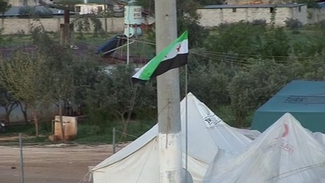 Syrian flag at the border between Syria and Turkey, moments after the UN deadline for a complete ceasefire passed.