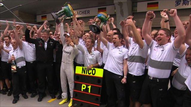 Mercedes celebrate Nico Rosberg's maiden victory