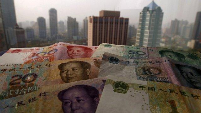 Yuan banknotes against Shanghai skyline
