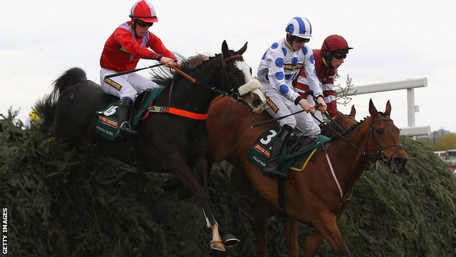 According to Pete (l) ridden by Harry Haynes clears The Chair alongside Hello Bud ridden by Sam Twiston-Davies.