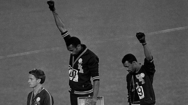 Tommie Smith, centre, and Jon Carlos, right, on the podium at the 1968 Olympics
