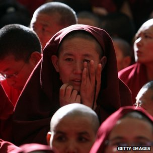 Exiled Tibetan monks attend the funeral ceremony of Jamphel Yeshi
