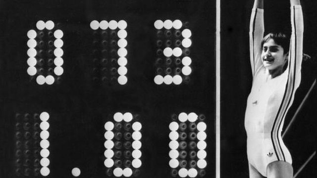 Gymnast Nadia Comaneci scores a perfect 10 in 1976 Montreal Olympics