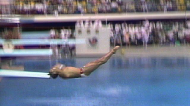 Greg Louganis hits his head on the board