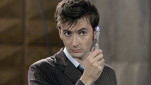 David Tennant as Doctor Who holding sonic screwdriver