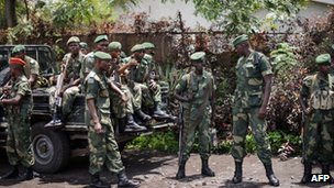 Soldiers of the Democratic Republic of Congo Armed Forces stand outside a general's residence in Goma on 11 April 2012