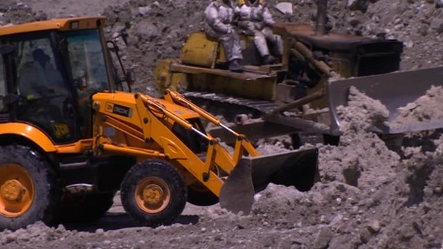 Diggers searching for bodies