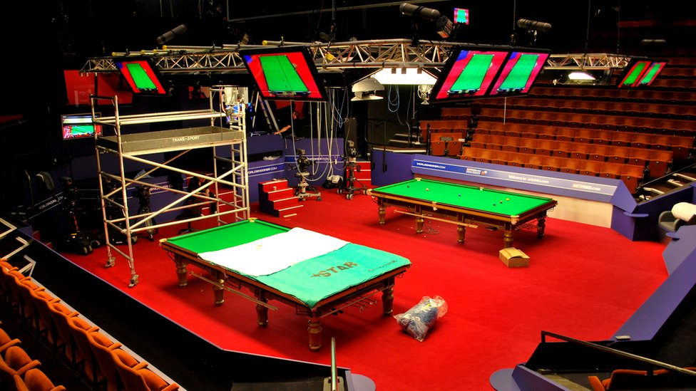Engineers setting up snooker at the 2012 World Ch&ionship at the Crucible Theatre Sheffield & BBC News - In pictures: World Snooker Championship 2012 set-up