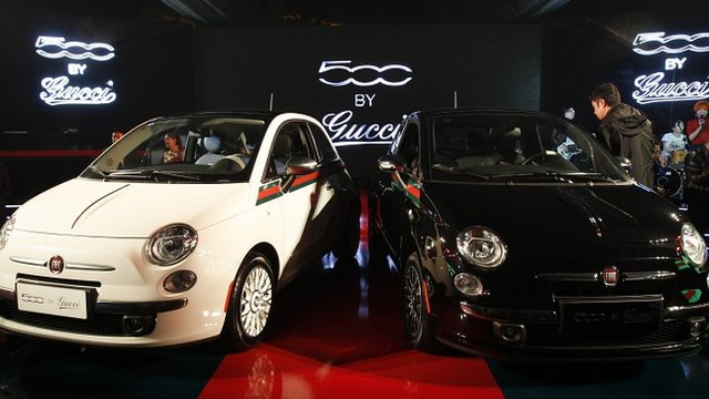 Two Fiat cars, co-designed with fashion house Gucci, on display in Beijing, China