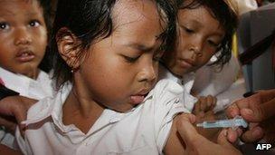 Child being immunised