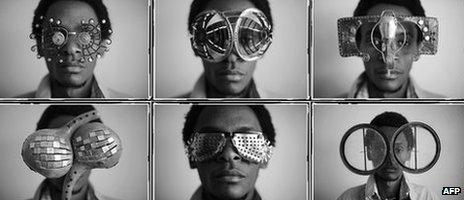 Kenyan artist Cyrus Kabiru posing with artwork resembling sunglasses on February 1, 2012 in Nairobi