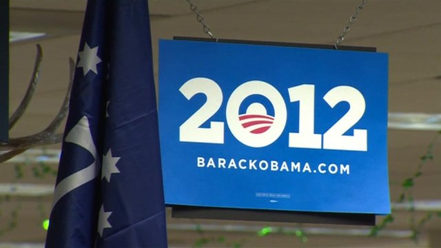 A Barack Obama banner and an American flag inside the headquarters