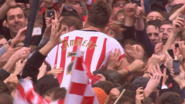 Southampton's Rickie Lambert celebrates promotion to the Premier League with the club's fans.