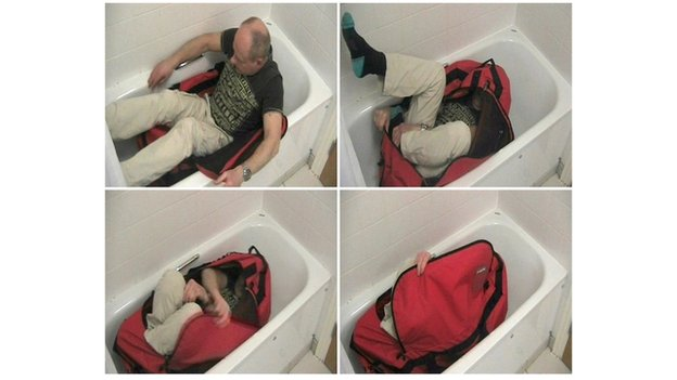 Man zipping himself in a bag