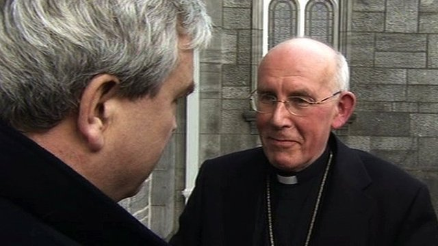 Darragh MacIntyre (L) speaks to Cardinal Sean Brady (R)
