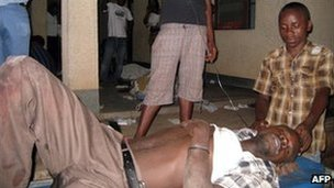 Victims of armed raiders who killed more than 20 people on September 18 and wounded about 20 others when they stormed a Burundi bar and opened fire on patrons is tended to at the Prince Regent Charles Hospital in Bujumbura on September 19, 2011.