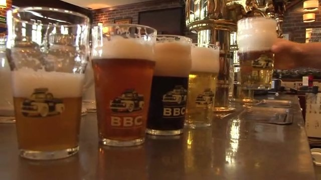 Pints of Bogata Beer Company beer lined up on a bar