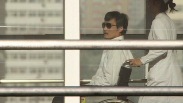 Chinese dissident Chen Guangcheng in a wheelchair