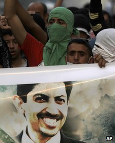 Bahraini anti-government protesters chant in support of jailed opposition rights activist Abdulhadi al-Khawaja on April 28 2012, in Abu Saiba, Bahrain.