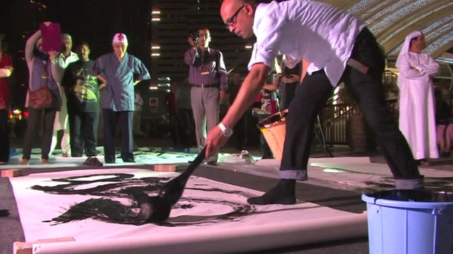 Artists at work at the Sharjah Calligraphy Biennial