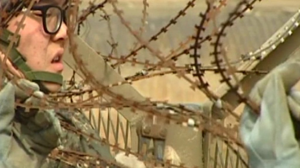 Soldier with barbed wire