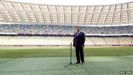 Ukraine's President Viktor Yanukovich addresses the media at the Olympic stadium in Kiev April 4, 2012