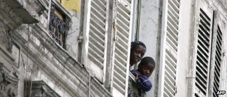 African children in France looking out of a window