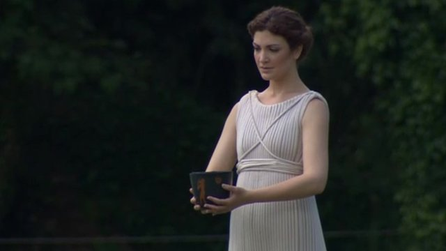 """An actress playing a """"high priestess"""" at the Olympic torch lighting ceremony in Greece"""