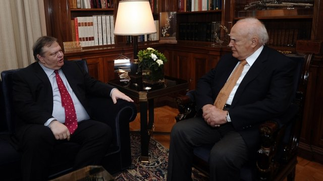 Greek Socialist leader Evangelos Venizelos, left, meets with Greek President Karolos Papoulias in Athens