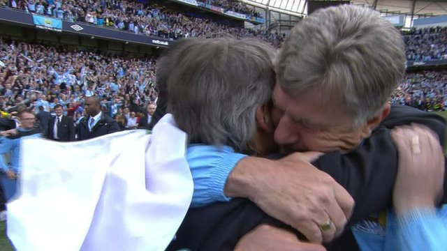 Manchester City's Roberto Mancini and Brian Kidd celebrate