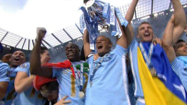 Manchester City lift the Premier League trophy