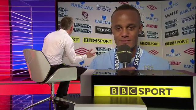 Gary Lineker (left, seated) interviews Manchester City captain Vincent Kompany