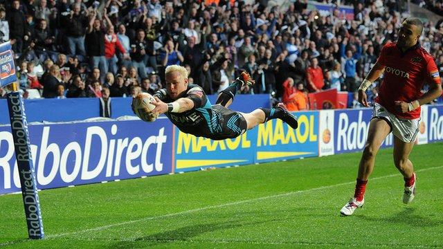 Ospreys winger Hanno Dirksen scores a try against Munster