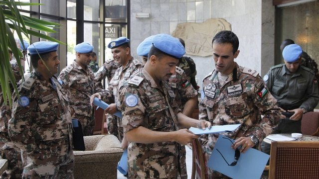 Members of the UN observers mission in Syria from Jordan gather at a hotel in Damascus