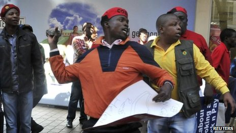 An angry COSATU supporter throws stones during a march by the Democratic Alliance (DA) South Africa's main opposition party in Johannesburg May 15, 2012.