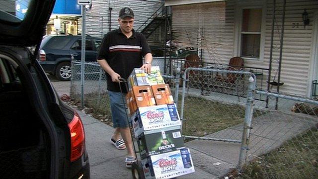 Man buying crates of beer in Quebec