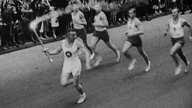 Archive footage of the torch relay