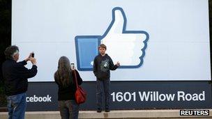 "Xavier Schmidt of Menlo Park, has his picture taken by his parents outside Facebook""s headquarters in Menlo Park, California"