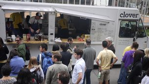 Customers waiting beside a Clover Food Lab truck