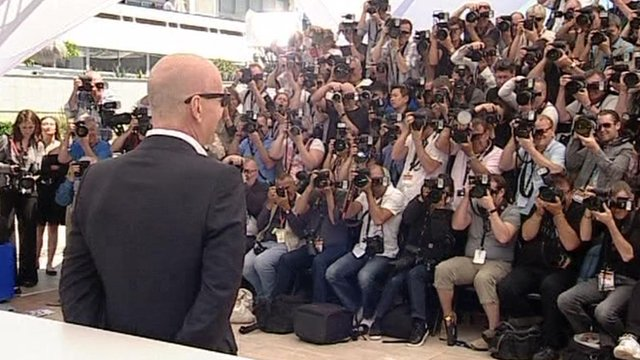 Bruce Willis in front of photograhers at Cannes