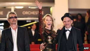 Kylie Minogue flanked by Holy Motors director Leos Carax (left) and actor Denis Lavant