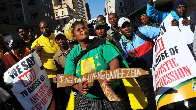 Supporters of the African National Congress demonstrate outside the Johannesburg court