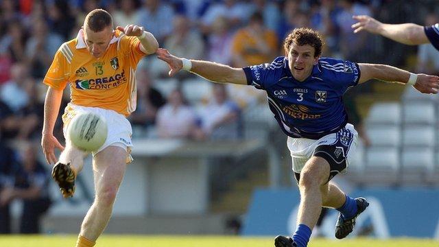 Paddy Cunningham evades Dermot Sheridan of Cavan
