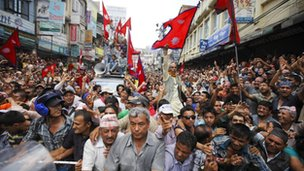 Members of the Brahmin-Chhetri Society protest near the constitution assembly building against federalism in Kathmandu