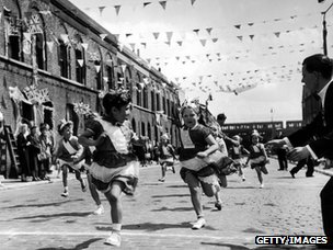 Children in London's East End enjoying a street party in celebration of the Coronation of Queen Elizabeth II, June 2nd 1953