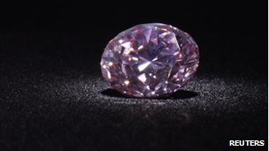 The Martian Pink, a 12.04-carat Fancy Intense pink (Type IIa) diamond, is shown during a media preview at Christie's in Hong Kong, 8 May, 2012